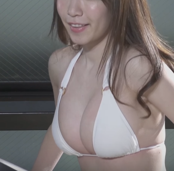 Check out this bizarre and sexy Japanese swimsuit girl video now!